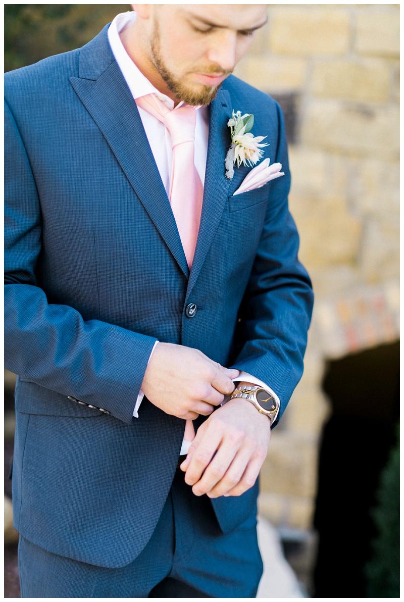 pink navy suit groom mountain