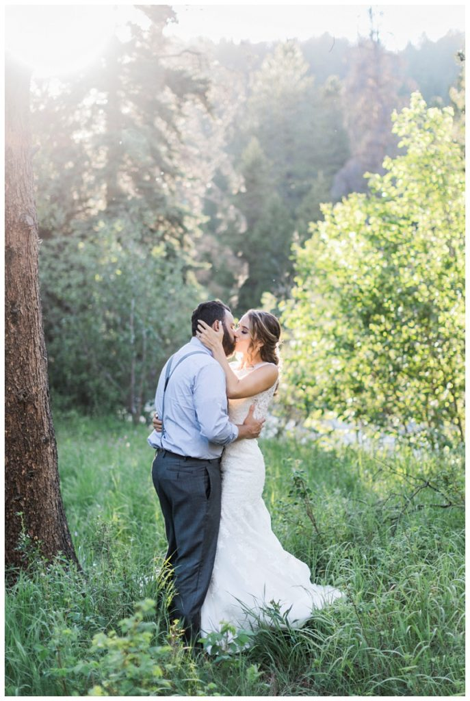 golden hour bride groom mountains kissing