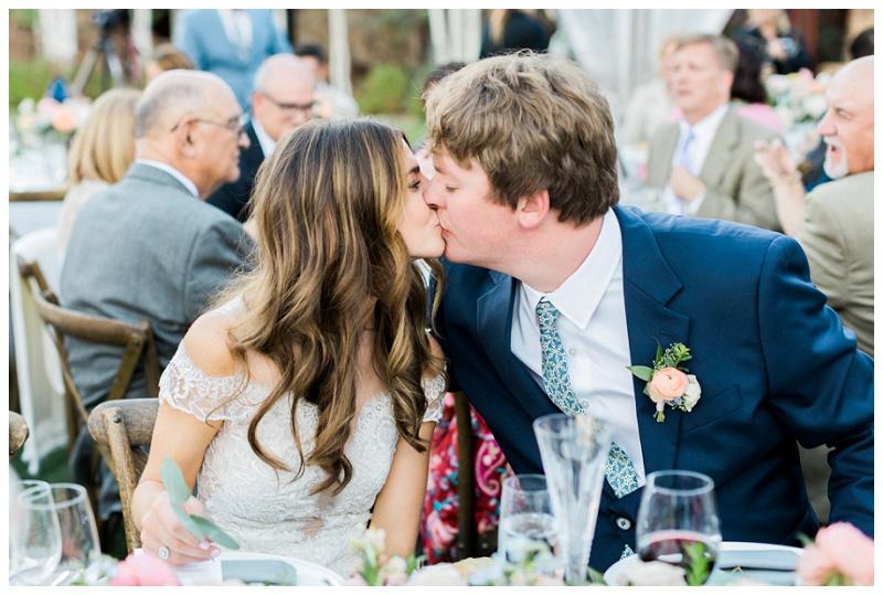 kisses wedding reception Ritz-Carlton, Bachelor Gulch Colorado summer mountain wedding outdoors
