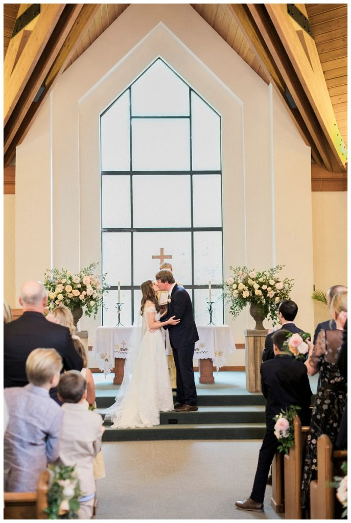 First kiss during ceremony at Beaver Creek Chapel Colorado Mountain Wedding