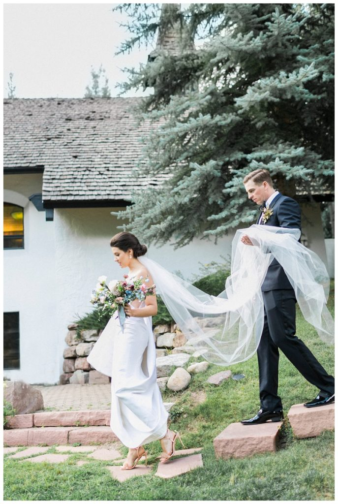 couple on wedding day at Interfaith Chapel Vail